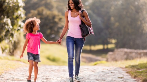Mother and daughter walking home after school and discussing anxiety