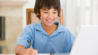 Young boy completing work for school without anxiety