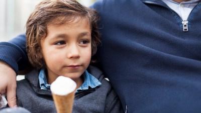 ADHD boy eating ice cream as a reward for good behavior