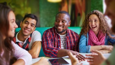 High school students with ADHD discussing class tests at diner