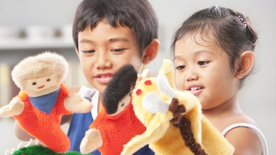 Children with ADHD using puppets to engage in play therapy