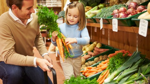 Father and daughter with ADHD shop for groceries