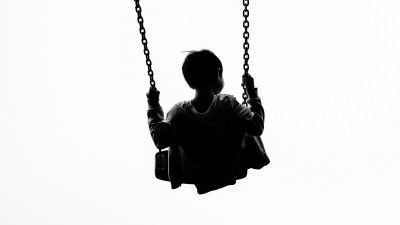 A child with symptoms of bipolar disorder swings at the park
