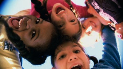 Group of happy children with ADHD are playing outside because being outside is a natural ADHD treatment