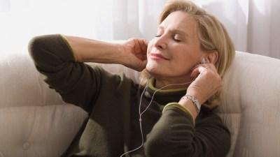 ADHD Senior woman listening to MP3 player
