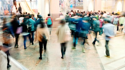 Commuters rushing through a train station to avoid the chronic lateness that comes with ADHD