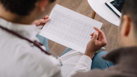 Doctor showing neurofeedback EEG results to a patient