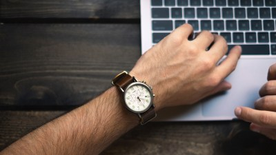 A man looks a this watch and overcomes self-defeating behaviors