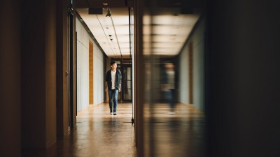 An ADHD teen with motivation problems walks down the school hallway