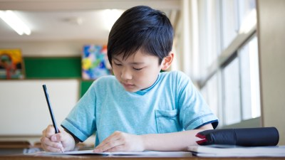 A young boy with ADHD getting organized to study for an upcoming test