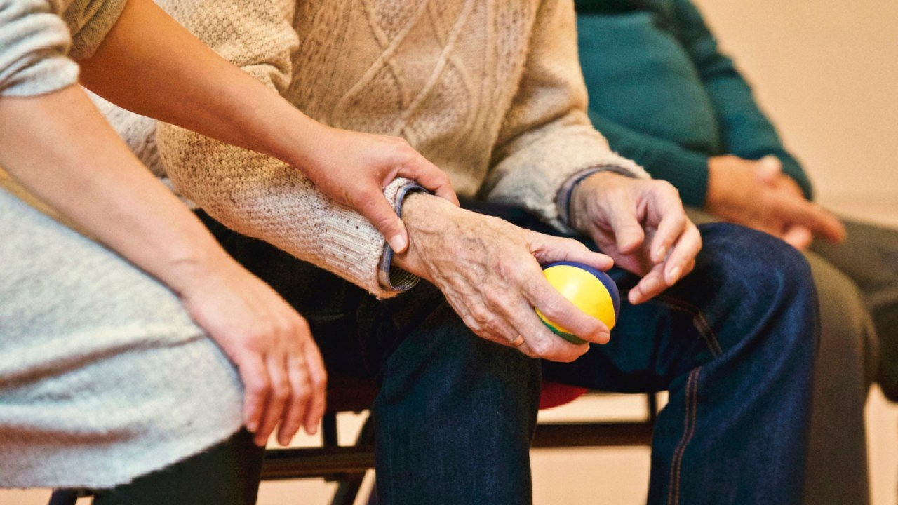 A woman with ADHD, depression, anxiety comforts an senior citizen.