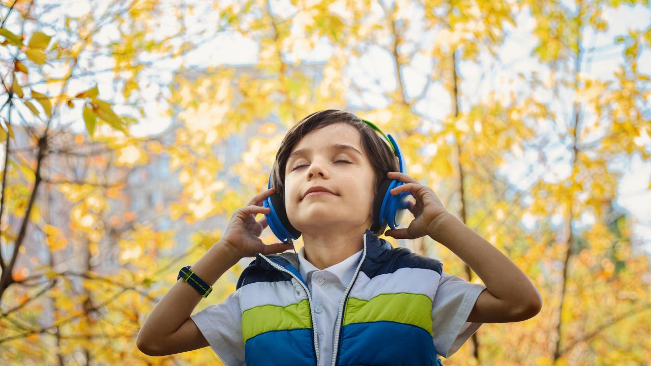 Boy with ADHD listening to headphones
