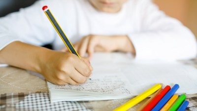 A child plugs away at too much homework.
