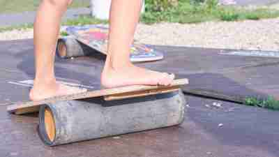 Child with ADHD playing on a balance board in the summertime