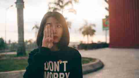 Girl with ADHD is anxious and wearing a don't worry sweatshirt