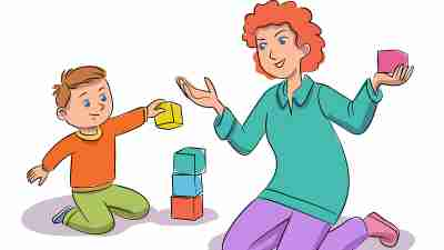A boy with ADHD plays block with his mother to build focus