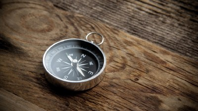Compass on wooden table representing the different directions an ADHD person can take with their career