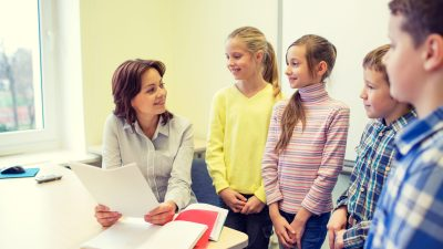Teacher engaging students with ADHD to improve their listening skills
