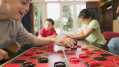 Family playing checkers