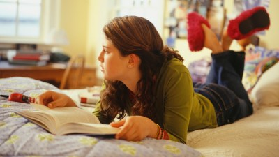 Distracted teen girl studying