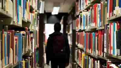 ADHD boy wandering through library