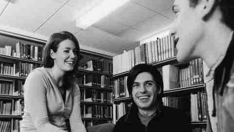 College friends studying in the library