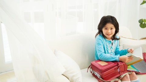 A young girl goes through her morning routine to get ready for school.