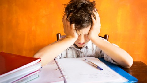 A boy struggles with homework, which appears to be an ADHD issue but may actually be OCD.