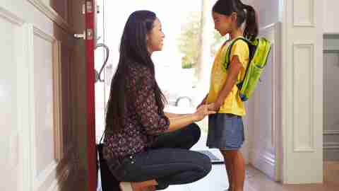 Mom helps child get ready for school to help with executive function disorder.