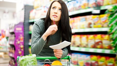 Confused woman with ADHD shopping in grocery store