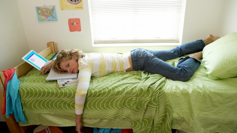 A college student getting some sleep, a common tip for new students