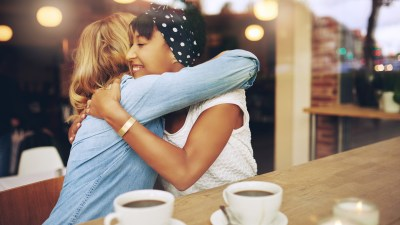A woman hugs her friend who has ADHD