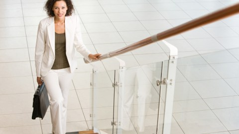 A woman climbs some stairs to activate her attention before continuing her job, an excellent way to manage ADHD in the workplace.