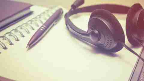 A notebook and headphones for use in music therapy for kids with adhd.