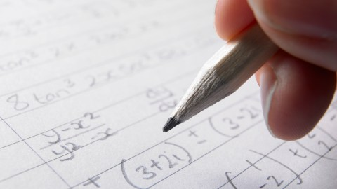 A student does practice problems to improve math skills