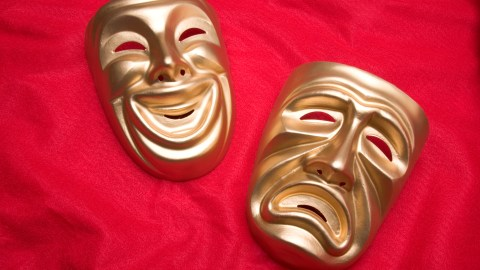 Comedy and tragedy masks, a metaphor for the ups and downs of ADHD stress management
