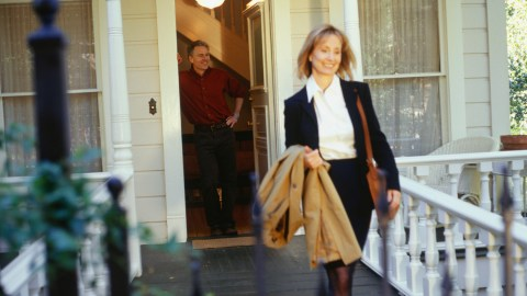 A businesswoman leaves her house early to get to work on time