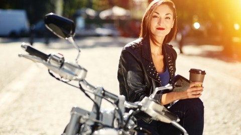 A woman on a motorcycle is giving herself positive affirmations.
