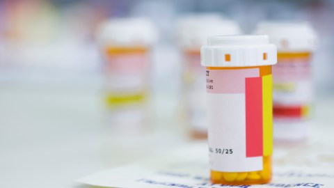 A pill bottle on top of a prescription. Read on to learn how ADHD medication works.