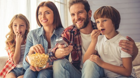 Family with children with ADHD watching a movie together