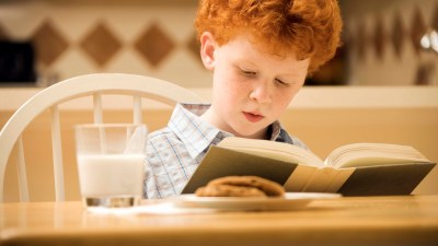 A boy with ADHD drinks milk and eats a light snack to help him fall asleep at bedtime