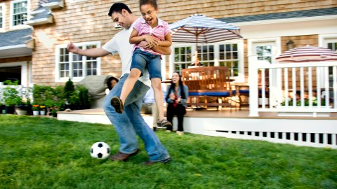 A dad plays soccer with his daughter with ADHD