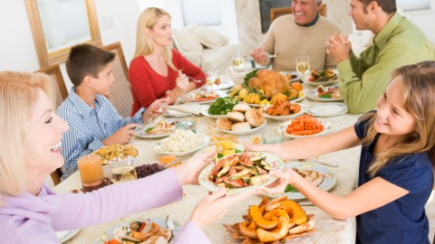A girl with ADHD practices social skills during a big family dinner