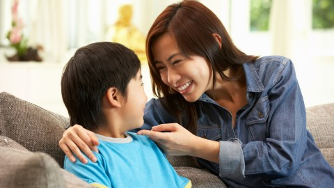 A mom congratulates her son with ADHD on learning how to make friends