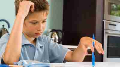 Boy with ADHD frustrated with writing assignment