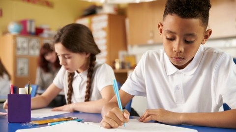 Two children with ADHD working on writing strategies in school