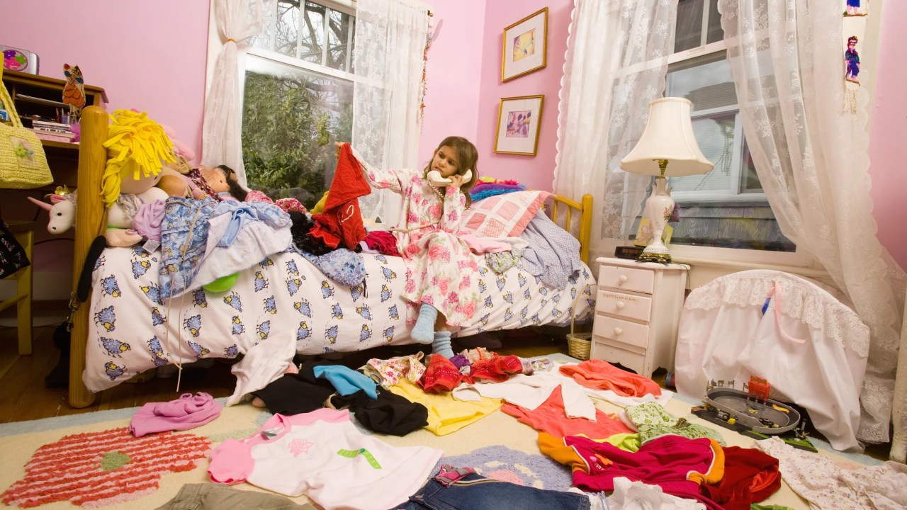A very messy bedroom that is in need of a through cleaning and organization effort.