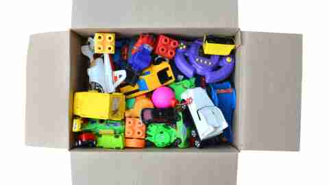 An organized box of toys — the result of cleaning up a messy bedroom