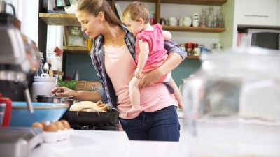 A mother with ADHD cooks with her child.