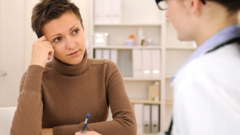 A young woman with ADHD in her doctor's office